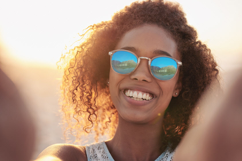 woman with sunglasses selfie